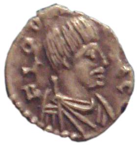 """Moneta di Odoacre, coniata a Ravenna nel 477. Notare i baffi """"barbarici"""" del re germanico."""